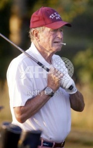 GHWB in motif belt playing golf