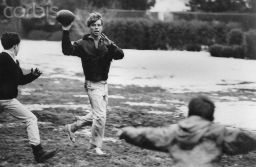 Bobby Kennedy playing football with family
