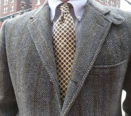 Grey tweed, yellow tie, and university striped shirt